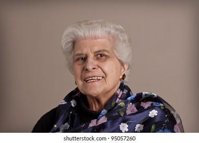 Senior lady portrait, smiling with copy space.