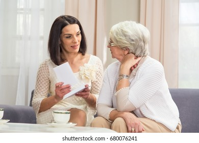 Senior lady receiving good news from a paper mail. See more Seniors