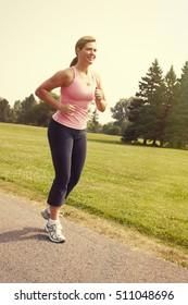 Senior lady running.