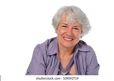Senior Lady smiling isolated on a white background