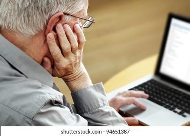 Senior with Laptop, focus on hand