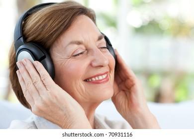 Senior listening to music