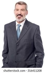 Senior male businessman posing to the camera