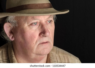 senior male close up portrait in hat