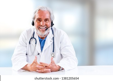 Senior Male doctor listening and discussing,with patient during telemedicine session.