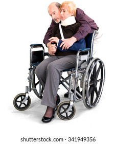 Senior Male & Female Couple with woman in wheelchair in casual outfit cuddling - Isolated