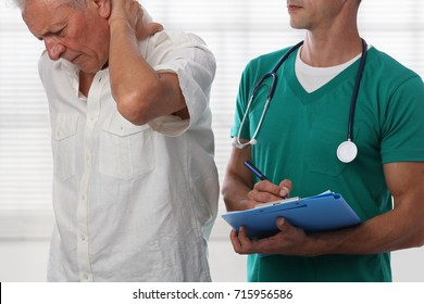 Senior male patient suffering from back pain during medical exam. Chiropractic, osteopathy, Physiotherapy. Alternative medicine, pain relief concept