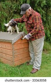senior male preparing dog house for painting