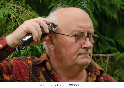senior male shaving and cutting his hair