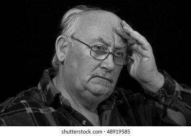 senior male worried concerned wearing glasses