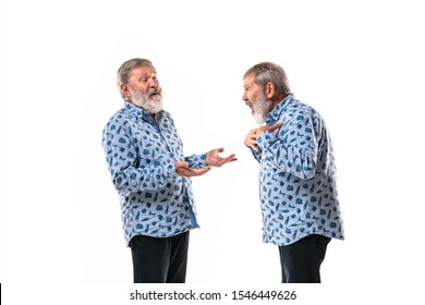 Senior man arguing with himself on white studio background. Concept of human emotions, expression, mental issues, internal conflict, split personality. Half-length portrait. Negative space. Question.