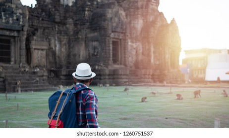 Senior man Asian with backpack are walking at Phra Prang Sam Yot. Ancient and historical attractions and one of the most important archaeology of Lopburi province thailand. Travel, Tourist Concept