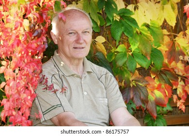 senior man in a autumn garden