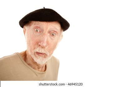Senior man in black beret with surprised expression