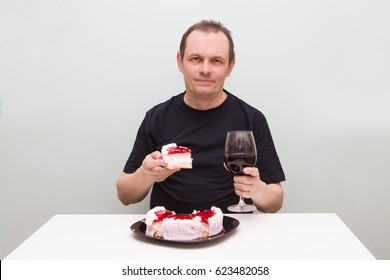 Senior man with cake. the elderly man celebrates birthday