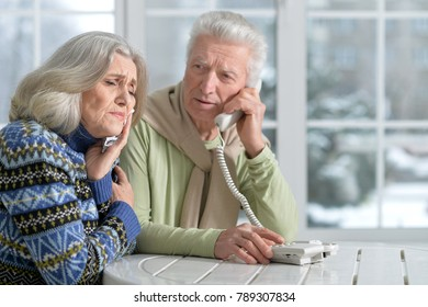 senior man  calling doctor with wife