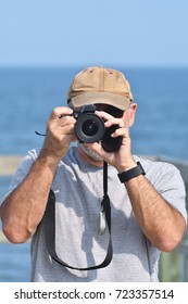 Senior Man with Camera on Boardwalk (Irving Eco-centre, la Dune de Bouctouche)