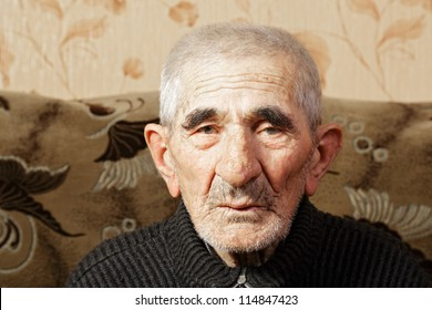 Senior man in casual head and shoulders portrait