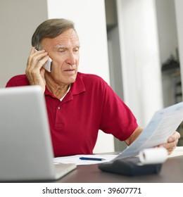 Senior man checking home finances. Copy space
