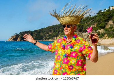 Senior man with cocktail drink at the tropical beach