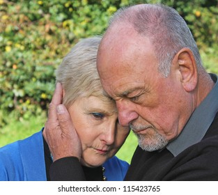 Senior man comforting beautiful wife