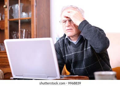 Senior man with a computer problem