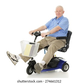 A senior man delightedly driving his electric scooter.  Motion blur on wheels.  On a white background.