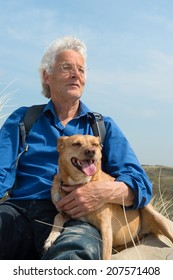 Senior man with dog in nature