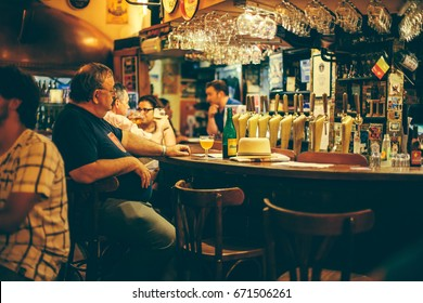 "Senior man drinking beer on Saturday evening at pub ""Delirium Ca"