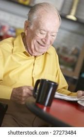 Senior man drinking hot beverage