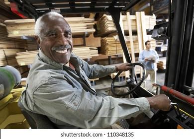 Senior man driving forklift