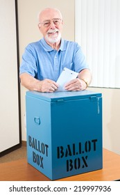Senior man dropping his ballot in the box at the election polling station.