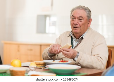 Senior man eating a healthy meal