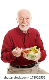 Senior man eating a healthy salad.  Isolated on white background.