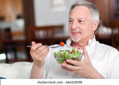 Senior man eating a salad