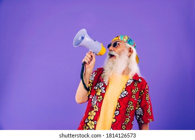 Senior man with eccentric look  - 60 years old man having fun, portrait on colored background, concepts about youthful senior people and lifestyle