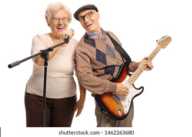 Senior man with an electric guitar and senior woman holding a microphone isolated on white background