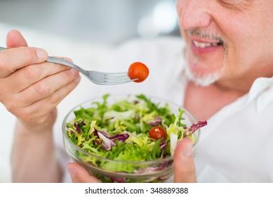 Senior man enjoying a healthy salad
