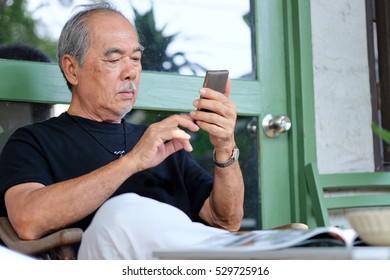 senior man enjoying on his phone