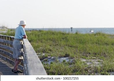A senior man enjoying the view on the Alabama gulf coast.