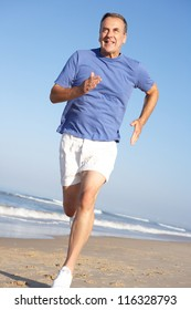 Senior Man Exercising On Beach