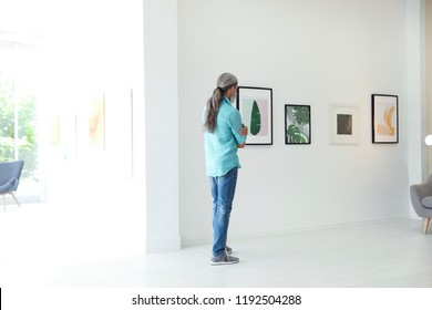 Senior man at exhibition in art gallery