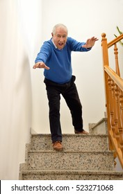 senior man falling down on the stairs