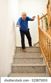 senior man falling down on the stairs at the home