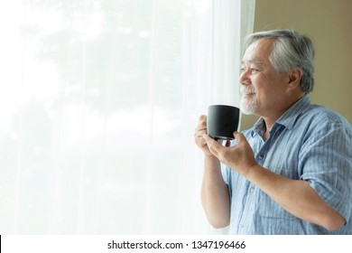 Senior man feel happy drinking coffee in the morning, enjoying time in his home indoor background - lifestyle senior elderly happiness concept