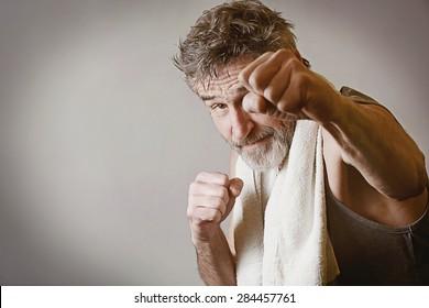 Senior man in fighting position