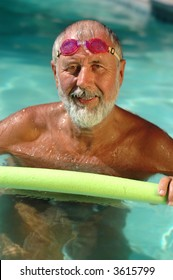 Senior man, a former professional swimmer, working out in the pool on a hot summer day