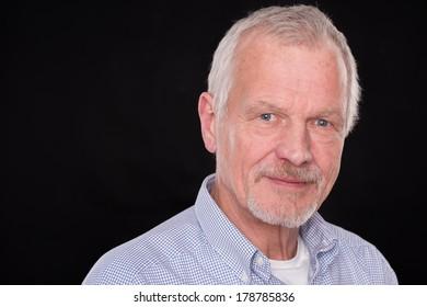 Senior man in front of black background