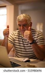 Senior man getting good news.