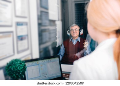 Senior man getting a hearing test at a doctors office,